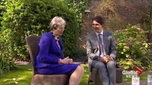 Trudeau meets with U.K.'s Theresa May in garden ahead of intelligence meetings